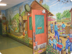 Entrance to gymnasium with mural